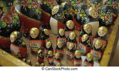 A large number of nesting dolls of different sizes on the table