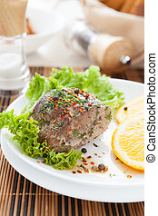 a large piece of juicy meat with spices