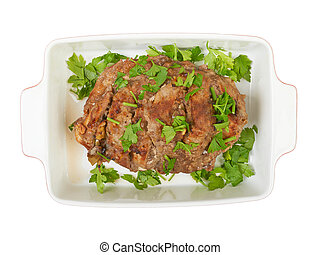 A large piece of veal pork cooked