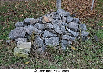 a large pile of gray stones on the street