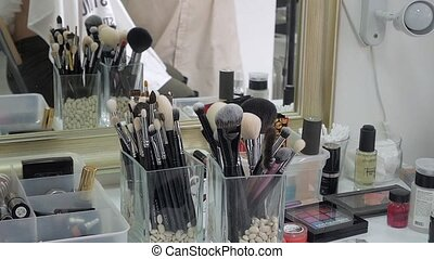 A large set of makeup brushes in the studio