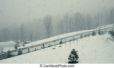 A large snowfall overlooking the road, heavy snow and snowstorm