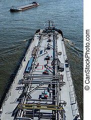 A large tanker ship sailing in Germany on the Rhine River. Transportation of oil, gas and gasoline