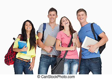 A laughing group of students as they look at the camera