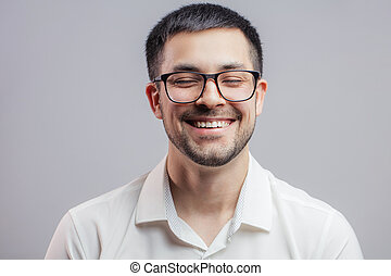 a laughing guy in formal clothes