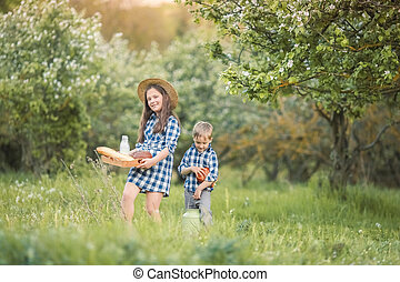 A Laughing kids brother and sister playing in a forest
