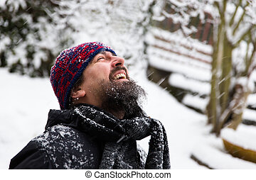 laughing man in front of a snowy background