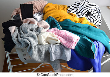 a laundry basket full of clothes
