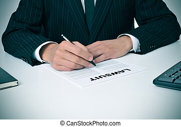 lawsuit - a lawyer in his office with a document with the...