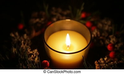 A lighted candle on a Christmas night - Lighted candle in a...