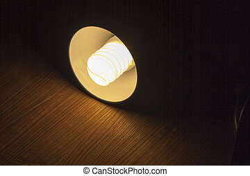 A lighted Lamp shines out of the darkness