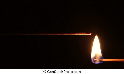 A lighted mantel match in the dark - Fire mantel matches on...