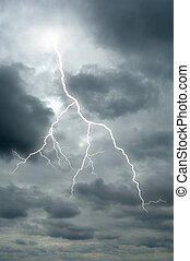 Lightening bolt flashes through a dramatic sky - A ...
