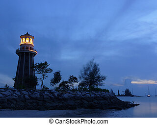lighthouse at dusk - A lighthouse at dusk. Picture taken in...