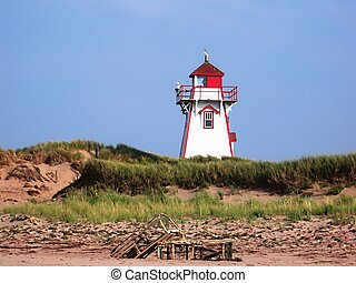 A lighthouse on Prince Edward Island with Lobster Traps