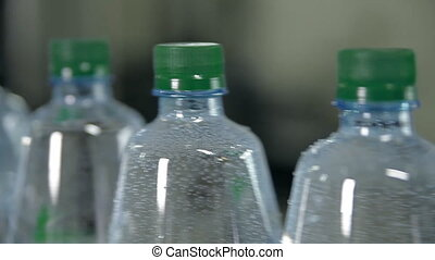 A line for bottling mineral water into bottles - Plastic...