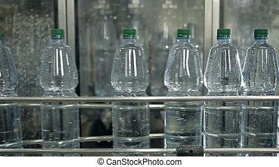 A line for bottling mineral water into bottles