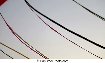a line of kites attached together flying in the air