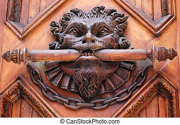 A lion door knob on an old church d