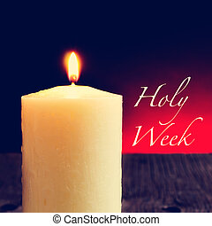 a lit candle and the text holy week