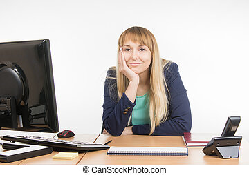 A little bit tired business woman behind a desk