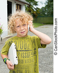 little blond boy playing with a smartphone