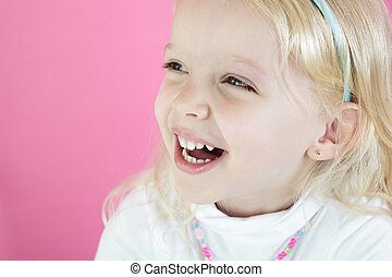 A Little blond girl isolated on pink  background