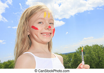little blond girl with paint on the face