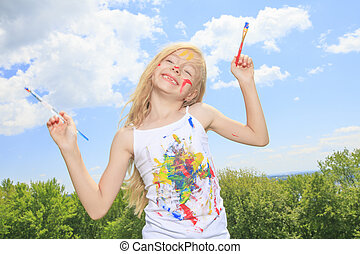 A little blond girl with paint on the face