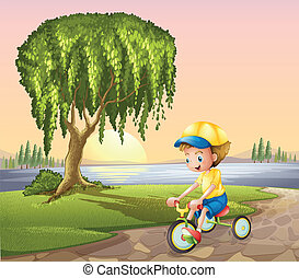 A little boy biking