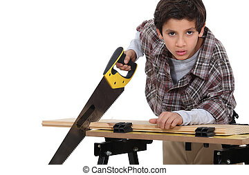 A little boy carpenter.