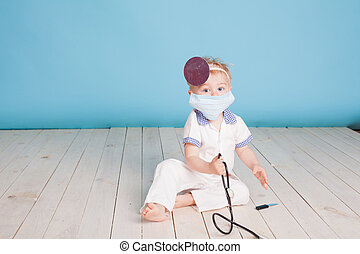 a little boy dressed as a doctor
