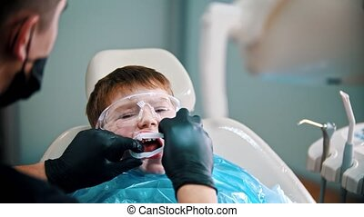 A little boy having his tooth done - putting on a mouth guard