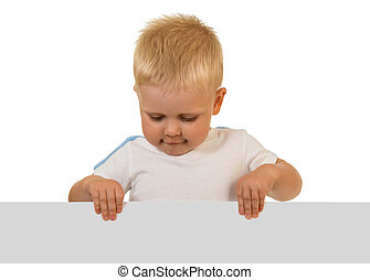 A little boy holding with two hands blank banner isolated on white