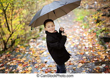 little boy in autumn october season