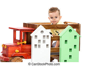 A little boy is playing with a toy car.