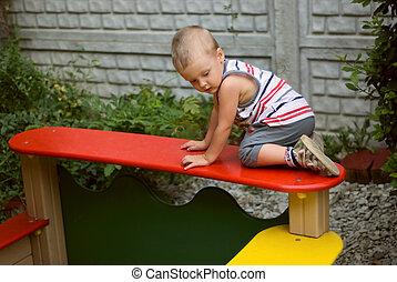 a little boy on playground