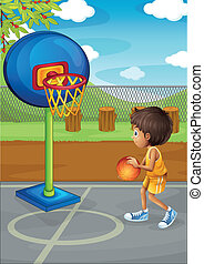 A little boy playing basketball