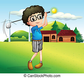 A little boy playing golf