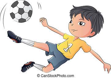 A little boy playing soccer
