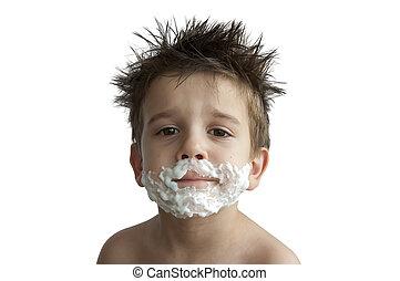 A little boy shaving