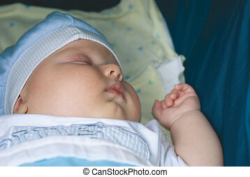 a little boy sleeping in carriage
