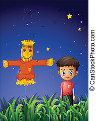 A little boy standing beside the scarecrow