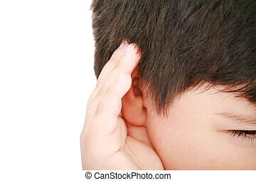 A little boy trying to hearing the sound around him - What...