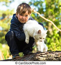 A little boy with a cat.