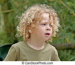 little boy with blond hair and curly