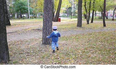 a little child plays with a squirrel in the Park