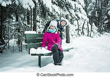Little girl and boy in winter season