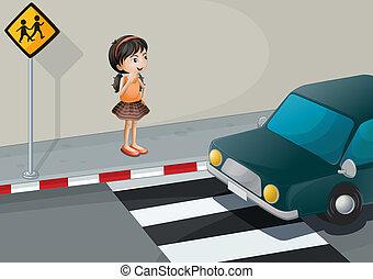 A little girl at the pedestrian lane