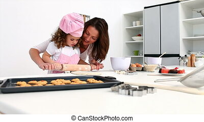 A little girl baking with her mother
